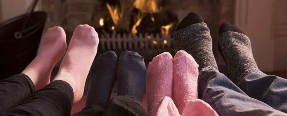 Family Feet warming at fireplace