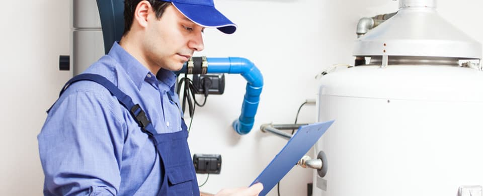 Technician servicing hot water